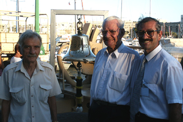 Ray Morton  and mates in front of  SS <i>Ohio's</i> bell at the 2002 Malta Reunion